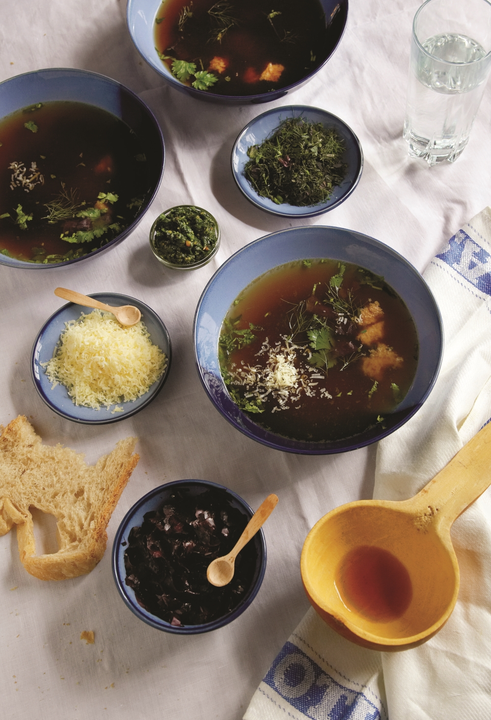 Broth served with herbs, cheese and bread from Gerry Galvin